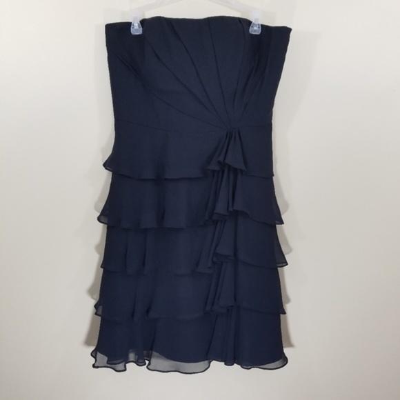 6771983451791 WHBM Black Strapless Ruffled Mini Cocktail Dress.  M_5b966c252beb79c5f12a2153. Other Dresses you may like. NWOT White House  Black Market ...